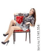 Девушка в пёстром халате сидит на старинном стуле, белый фон. Стоковое фото, фотограф Евгений Липский / Фотобанк Лори