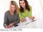 Купить «Две молодые студентки занимаются домашним заданием», фото № 3145770, снято 28 марта 2009 г. (c) CandyBox Images / Фотобанк Лори