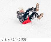 Купить «Девочка едет  по снежной горке на ледянке», эксклюзивное фото № 3146938, снято 10 января 2012 г. (c) Игорь Низов / Фотобанк Лори