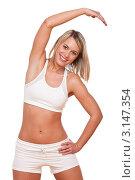 Купить «Зарядка счастливой молодой женщины в белом», фото № 3147354, снято 3 апреля 2009 г. (c) CandyBox Images / Фотобанк Лори