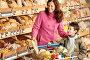 Портрет улыбающихся мамы и сына в супермаркете, фото № 3164158, снято 15 мая 2009 г. (c) CandyBox Images / Фотобанк Лори