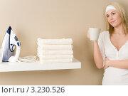 Купить «Домохозяйка пьет кофе и смотрит на утюг и белье», фото № 3230526, снято 1 февраля 2011 г. (c) CandyBox Images / Фотобанк Лори