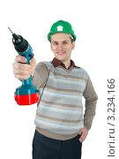 Улыбающийся рабочий держит электродрель в руках. Стоковое фото, фотограф Дмитрий Поляков / Фотобанк Лори