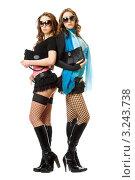 Купить «Две девушки в сексуальных нарядах стоят на белом фоне», фото № 3243738, снято 13 февраля 2010 г. (c) Сергей Сухоруков / Фотобанк Лори