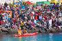 Зрители и лодка участников ежегодного соревнования «Regata de Achipencos» в Пуэрто-дель-Росарио, Фуэртевентура, Канарские острова, фото № 3293882, снято 19 февраля 2012 г. (c) Tamara Kulikova / Фотобанк Лори
