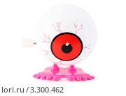 Купить «Игрушечный заводной глаз на белом фоне», фото № 3300462, снято 28 сентября 2010 г. (c) Losevsky Pavel / Фотобанк Лори