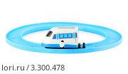 Купить «Заводной белый поезд  на круговой железной дороге на белом фоне», фото № 3300478, снято 28 сентября 2010 г. (c) Losevsky Pavel / Фотобанк Лори