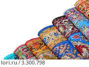 Купить «Яркие разноцветные ковры на белом фоне», фото № 3300798, снято 21 января 2011 г. (c) Losevsky Pavel / Фотобанк Лори