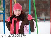 Купить «Красивая молодая женщина в розовой шапочке сидит на качелях на детской площадке», фото № 3300870, снято 31 января 2010 г. (c) Losevsky Pavel / Фотобанк Лори