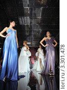 Купить «Девушки модели стоят на подиуме в вечерних платьях», фото № 3301478, снято 14 февраля 2011 г. (c) Losevsky Pavel / Фотобанк Лори