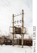 Купить «Трансформатор на опорах в сельской местности», эксклюзивное фото № 3328322, снято 1 марта 2012 г. (c) Игорь Низов / Фотобанк Лори
