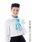 Купить «Стюардесса держит чашку с блюдцем, белый фон», фото № 3340810, снято 22 сентября 2011 г. (c) Raev Denis / Фотобанк Лори