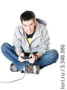 Купить «Парень в ярости с джойстиком для игровой приставки», фото № 3348986, снято 5 февраля 2010 г. (c) Сергей Сухоруков / Фотобанк Лори