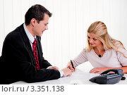 Купить «Девушка подписывает контракт», фото № 3351138, снято 8 декабря 2019 г. (c) Erwin Wodicka / Фотобанк Лори