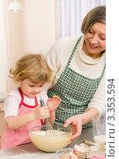 Купить «Бабушка с внучкой перемешивают тесто», фото № 3353594, снято 28 января 2012 г. (c) CandyBox Images / Фотобанк Лори