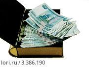 Пачка денег в копилке, белый фон. Стоковое фото, фотограф Vladimir Shashkin / Фотобанк Лори
