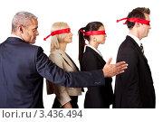 Купить «Бизнесмен указывает путь троим людям с завязанными глазами», фото № 3436494, снято 13 ноября 2010 г. (c) Андрей Попов / Фотобанк Лори
