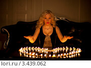 Купить «Портрет красивой девушки, сидящей перед столиком на котором свечами выставлено сердечко», фото № 3439062, снято 23 апреля 2018 г. (c) Литвяк Игорь / Фотобанк Лори