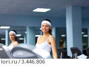 Купить «Женщины занимаются фитнесом в спортзале», фото № 3446806, снято 1 декабря 2011 г. (c) Sergey Nivens / Фотобанк Лори