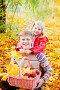 Брат и сестра в осеннем саду с корзиной яблок, фото № 3481890, снято 16 октября 2011 г. (c) Майя Крученкова / Фотобанк Лори