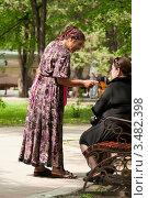 """Купить «Гадалка """"обрабатывает"""" клиента», фото № 3482398, снято 1 мая 2012 г. (c) WalDeMarus / Фотобанк Лори"""