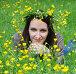 Портрет прекрасной молодой женщины в венке из лютиков, лежащей на цветущем лугу, фото № 3510486, снято 7 мая 2012 г. (c) Анна Мартынова / Фотобанк Лори