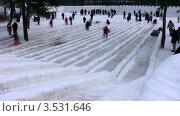 Купить «Люди на ледяных горках, таймлапс», видеоролик № 3531646, снято 18 января 2009 г. (c) Losevsky Pavel / Фотобанк Лори