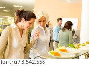 Купить «Девушки у прилавка в столовой», фото № 3542558, снято 6 апреля 2012 г. (c) CandyBox Images / Фотобанк Лори