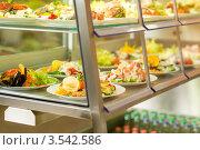Купить «Еда в витрине столовой», фото № 3542586, снято 6 апреля 2012 г. (c) CandyBox Images / Фотобанк Лори