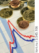 Монеты евро на финансовом графике. Стоковое фото, фотограф Галина Власова / Фотобанк Лори