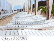 Купить «Белые пустые пластиковые лежаки под защитным навесом на пляже», фото № 3567078, снято 1 мая 2012 г. (c) Кекяляйнен Андрей / Фотобанк Лори