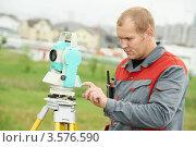 Купить «Геодезист работает с тахеометром на местности», фото № 3576590, снято 17 мая 2012 г. (c) Дмитрий Калиновский / Фотобанк Лори