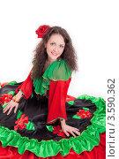 Женщина в яркой одежде цыганки на белом фоне. Стоковое фото, фотограф Евгений Ковылин / Фотобанк Лори