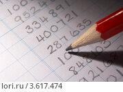 Купить «Карандаш и столбец цифр на бумаге», фото № 3617474, снято 1 сентября 2011 г. (c) Monkey Business Images / Фотобанк Лори