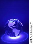 Стеклянный земной шар с подсветкой на синем фоне. Стоковое фото, фотограф Losevsky Pavel / Фотобанк Лори
