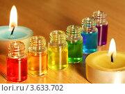 Купить «Шесть флаконов с разноцветными ароматическими маслами и морские звезды на столе», фото № 3633702, снято 14 апреля 2011 г. (c) Losevsky Pavel / Фотобанк Лори