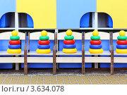 Купить «Яркие пирамидки стоят на стульях в детском саду», фото № 3634078, снято 5 марта 2011 г. (c) Losevsky Pavel / Фотобанк Лори