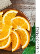 Нарезанный апельсин. Стоковое фото, фотограф Gerasimova Inga / Фотобанк Лори