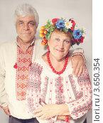Купить «Портрет украинской пожилой пары в национальных костюмах», фото № 3650354, снято 24 июня 2012 г. (c) Юлия Маливанчук / Фотобанк Лори