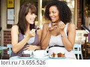 Купить «Две подруги едят торт за столиком в кафе», фото № 3655526, снято 30 сентября 2011 г. (c) Monkey Business Images / Фотобанк Лори