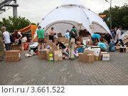 Купить «Пункт сбора гуманитарной помощи для пострадавших от наводнения на Кубани», эксклюзивное фото № 3661522, снято 11 июля 2012 г. (c) Наталья Волкова / Фотобанк Лори
