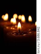 Купить «Горящая свеча на фоне других свеч», фото № 3686842, снято 14 ноября 2009 г. (c) Александр Скопинцев / Фотобанк Лори