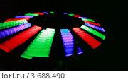 Купить «Иллюминация. Мелькающие разноцветные панели на темном фоне», видеоролик № 3688490, снято 6 мая 2010 г. (c) Losevsky Pavel / Фотобанк Лори