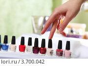 Купить «Женская рука выбирает лак для ногтей», фото № 3700042, снято 14 марта 2012 г. (c) Sergey Nivens / Фотобанк Лори