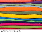 Фон из разноцветной свернутой одежды. Стоковое фото, фотограф Константин Примачук / Фотобанк Лори