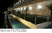 Купить «Пара гуляет по палубе корабля ночью», видеоролик № 3712202, снято 18 ноября 2010 г. (c) Losevsky Pavel / Фотобанк Лори