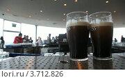 Купить «Два бокала пива на столе в кафе», видеоролик № 3712826, снято 4 ноября 2010 г. (c) Losevsky Pavel / Фотобанк Лори