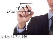 Преподаватель пишет математическую формулу. Стоковое фото, фотограф Vycheslav Leskovskiy / Фотобанк Лори
