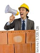 Купить «Инженер-строитель за кирпичной стеной кричит в громкоговоритель», фото № 3720126, снято 22 мая 2012 г. (c) Elnur / Фотобанк Лори