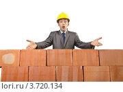 Купить «Удивленный строитель разводит руками», фото № 3720134, снято 22 мая 2012 г. (c) Elnur / Фотобанк Лори